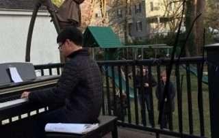 STUDENT PLAYING PIANO IN BACKYARD