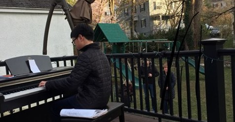 STUDENT PLAYING PIANO IN BACKYARD