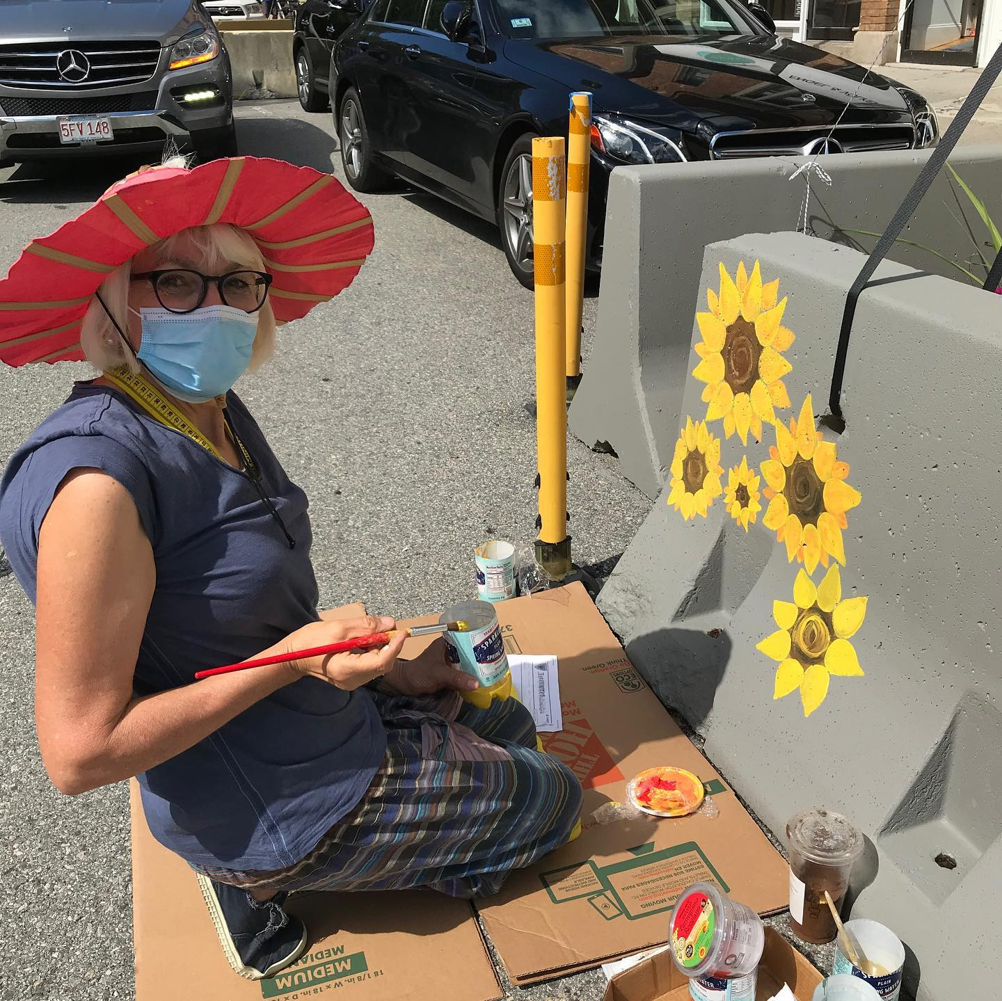 Barrier Painting Woman-Artists painting sunflowers at Farmstead