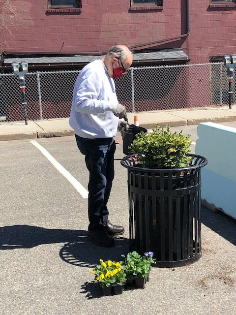 Older Man Watering Plants