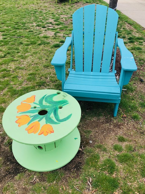 Green table with orange flowers newton to blue Adirondack chair