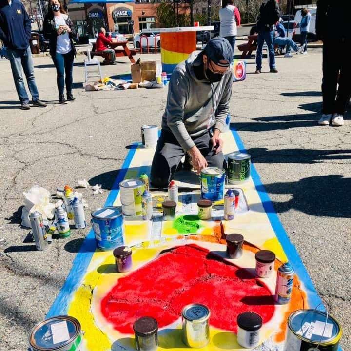 painting heart on street