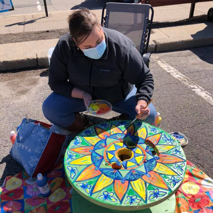 woman painting cable table