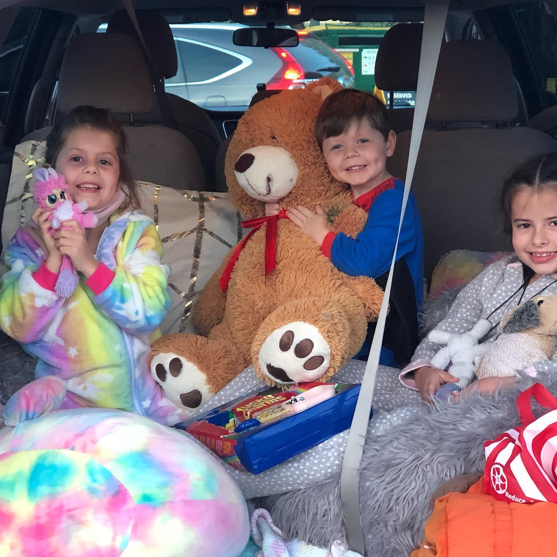 Kids in Trunk with Teddy Bears