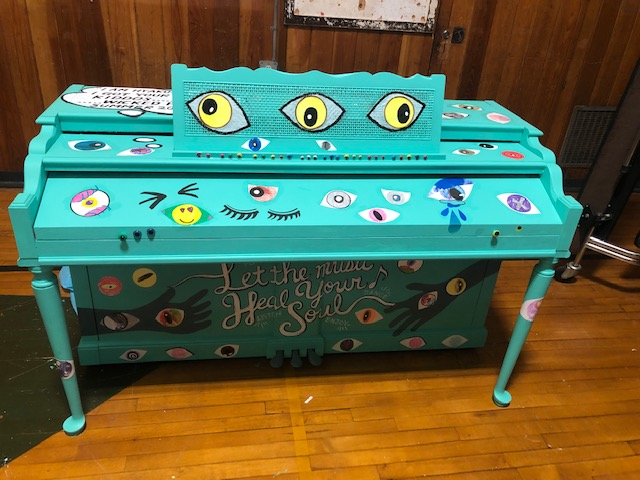 blue piano with eye
