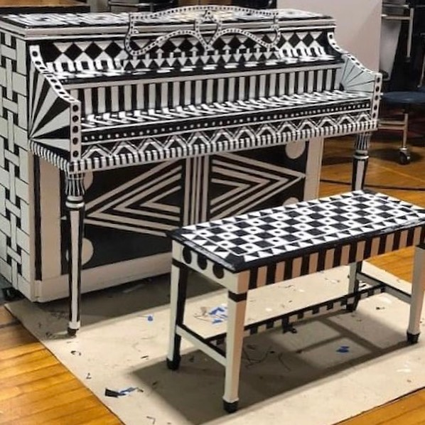 Side view of black and white patterned piano