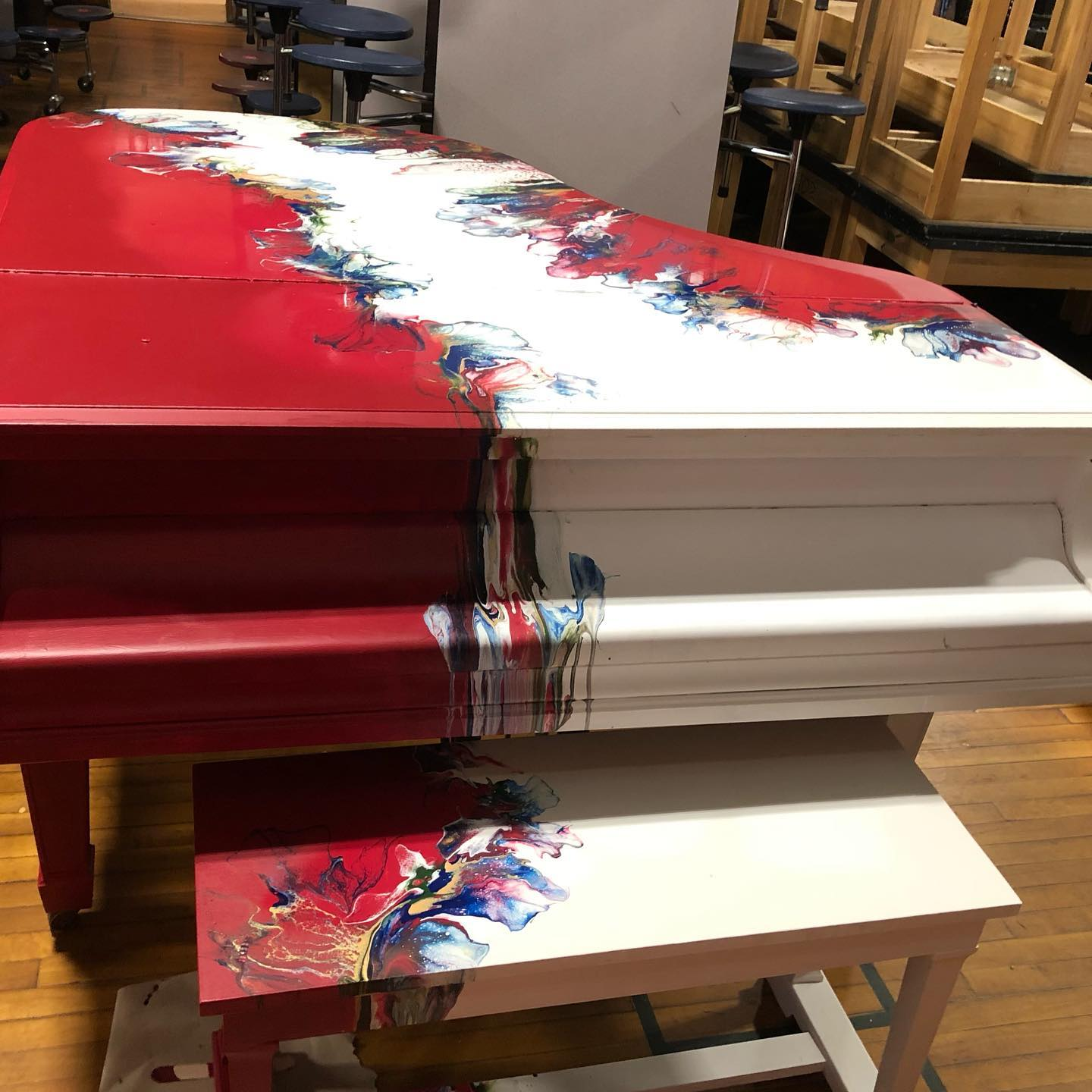 Red and White piano with flowers dripping down center and sides