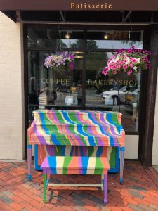 Swirls of paint on a piano outside a bakery