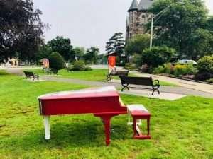 Red Grand Piano in Newton Centre Green