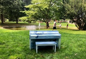 Light blue piano with white fish outside