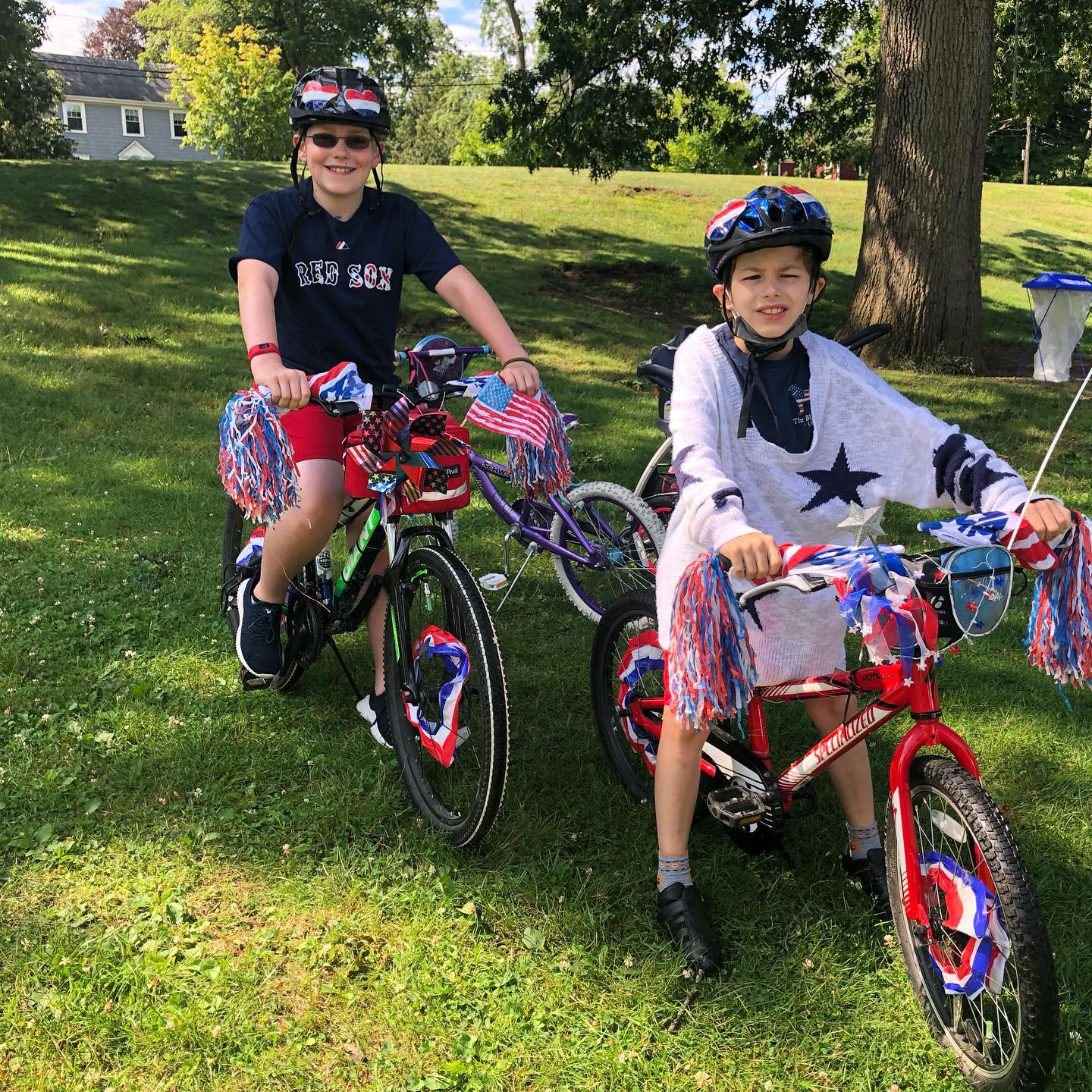 Boys on bike in red, white and blue